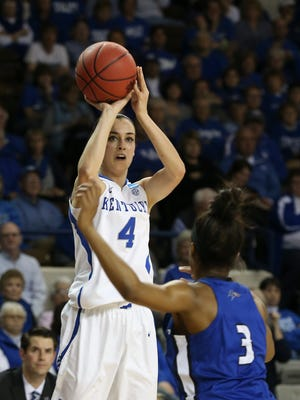 UK's Maci Morris, #4, shoots against UNC-Asheville's Chatori Major, #3, during their NCAA Tournament game in Lexington.
