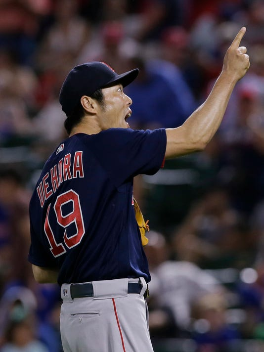 Boston Red Sox pitcher Koji Uehara celebrates after the final out of the ninth inning of a baseball game against the Texas Rangers in Arlington, Texas, Friday, June 24, 2016. The Red Sox won 8-7. (AP Photo/LM Otero)
