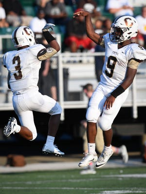 Central's Tre'Jon Evans (3) and Tor'Jon Evans (9) celebrate as Evansville Central plays Owensboro Apollo in the first game of a double header at the Independence Bank Border Bowl played at Steele Stadium in Owensboro, August 25, 2017.