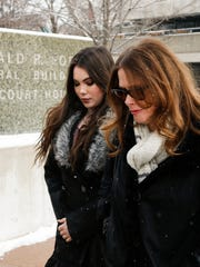 """Fierce Five"" Olympic gold medalist McKayla Maroney, left, arrives at the Gerald R. Ford Federal Building Courthouse Thursday morning, Dec. 7, 2017, in Grand Rapids, Michigan, where former gymnastics doctor Larry Nassar was sentenced to three consecutive 20 year sentences on child pornography charges."
