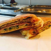 A Cuban sandwich at Chupacabra Latin Cafe, newly opened in Reynold's Village.