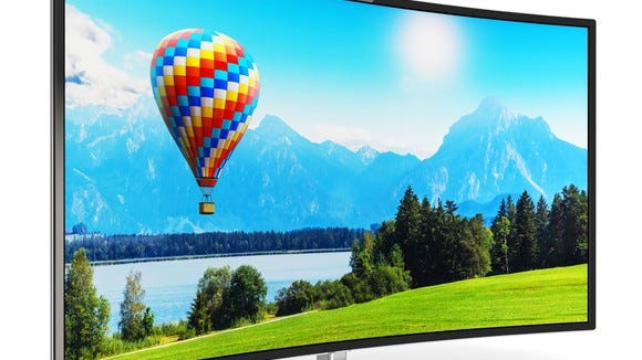 Curved big-screen TV, displaying a serene landscape with a hot-air balloon.