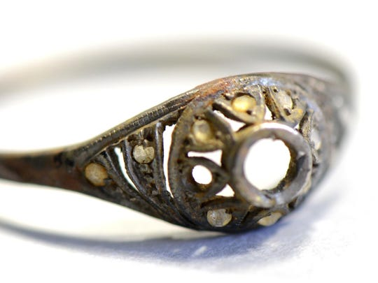 A gold ring that was found by curators of Auschwitz - Birkenau Museum in a metal mug with double bottom is pictured on May 19, 2016, in Oswiecim.