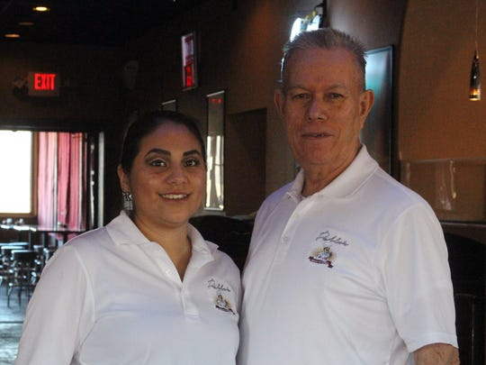 Owner Pablo Macias, right, and manager Melissa Cano