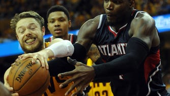 May 24, 2015; Cleveland, OH, USA; Cleveland Cavaliers guard Matthew Dellavedova (8) fights with Atlanta Hawks forward Paul Millsap (4) for the ball during the fourth quarter in game three of the Eastern Conference Finals of the NBA Playoffs at Quicken Loans Arena. Mandatory Credit: Ken Blaze-USA TODAY Sports ORG XMIT: USATSI-225528 ORIG FILE ID:  20150524_mta_bk4_192.JPG