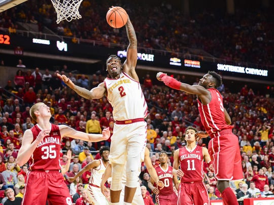 Iowa State Cyclones forward Cameron Lard (2) grabs a rebound as Oklahoma Sooners forward Brady Manek (35) and forward Khadeem Lattin (3) defend during the second half at James H. Hilton Coliseum.