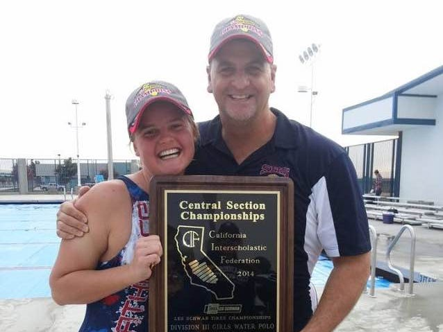 Strathmore's Carly Innis and coach Tom Harrison.