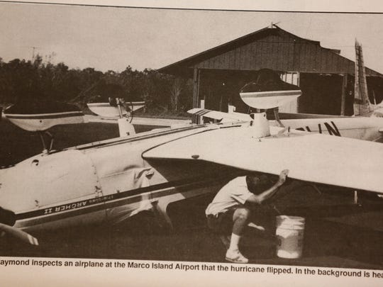 A photo published in the Marco Eagle, courtesy of the Marco Island Historical Museum, shows an overturned plane at Marco Island airport in the aftermath of Hurricane Andrew in August 1992. Photos taken by Marco Eagle correspondent Deborah Wight.