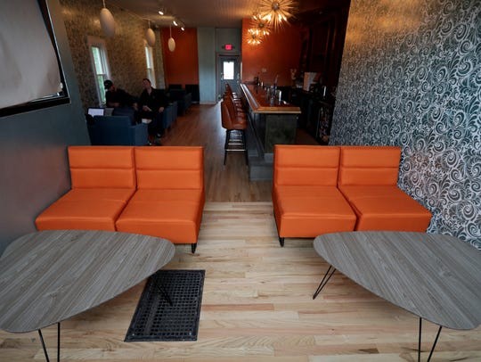 The bar at 2151 S. Kinnickinnic Ave. has a midcentury-modern