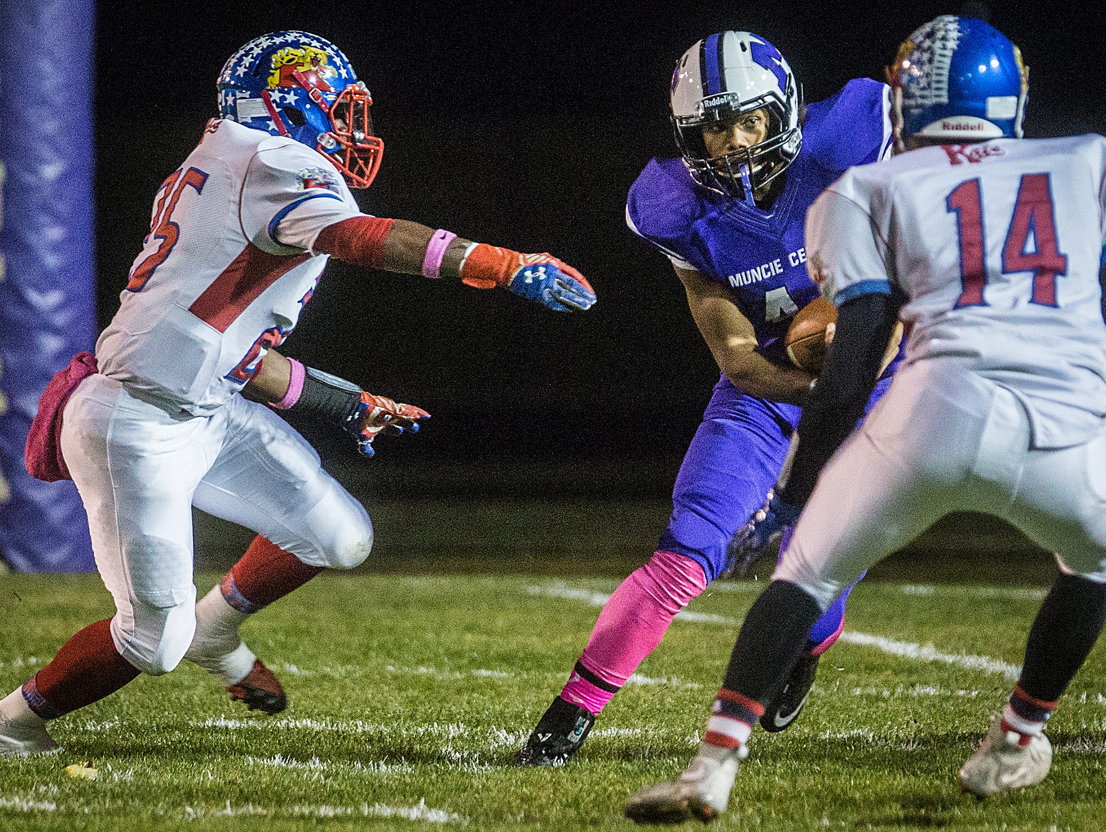 Central's Andre Wells looks for an opening in Kokomo's defense during their game at Central Friday, Oct. 30, 2015.