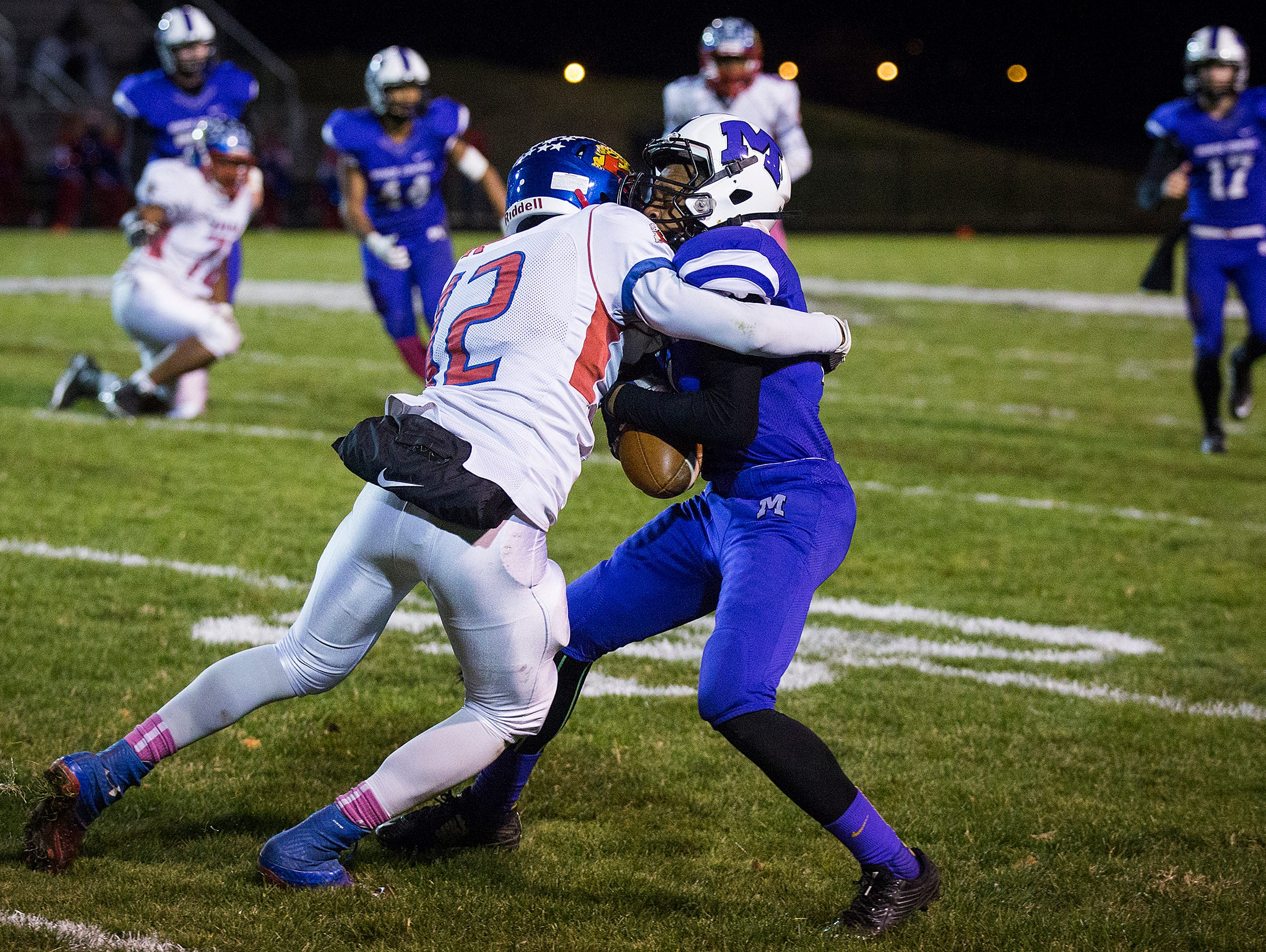 Central's Eliseus Young struggles against Kokomo's defense during their game at Central Friday, Oct. 30, 2015.