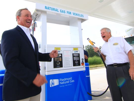 U.S. Rep. Jeff Duncan (left), South Carolina Third Congressional District, shares a laugh with Stewart Spinks, founder and chairman of the board for Spinx Company, during the 2015 grand opening of the Compressed Natural Gas pumps at the Spinx on S.C. 28 Bypass in Anderson. Greenville, Anderson, and Clemson bus systems are moving away from diesel fuel.