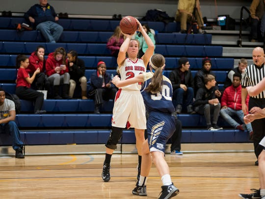 Port Huron's Madeline Trombly (24) shoots the ball