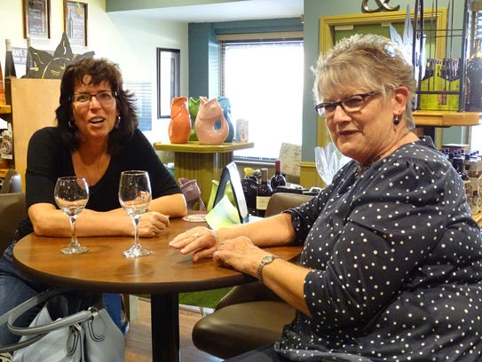 Barb Kinney, left, and Barb Anthony enjoy glasses of