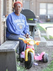 Neighborhood resident and activist Sherry Hunter sits