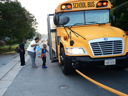 Students catch the school bus in Exmore, Va.
