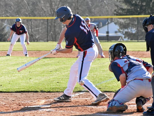 Chambersburg's Kaden Hoover (11) check swings at a ball during a Mid Penn Commonwealth division game earlier this year. Hoover had three RBIs in Chambersburg's opening game of the New Oxford tournament.