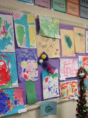 Children's artwork is proudly displayed at the 20th