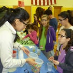BASF brought a mobile Candy Chemistry Lab for all to enjoy. Pictured are Grace Lazzarrotti of Sandshore School, Raquel D'Amico and Amy Meier of Mount Olive Middle School.