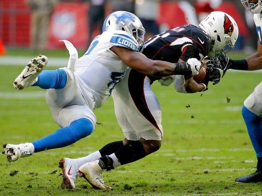 Arizona Cardinals running back David Johnson is hit by Detroit Lions middle linebacker Jarrad Davis, left, during the first half of NFL football game, Sunday, Dec. 9, 2018, in Glendale, Ariz. (AP Photo/Rick Scuteri)
