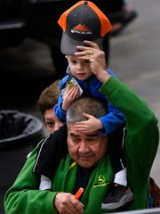 Martin Hernandez puts a cap on his grandson Maxtin Tuesday as they tour the Texas Farm-Ranch-Wildlife Expo at the Taylor County Coliseum.