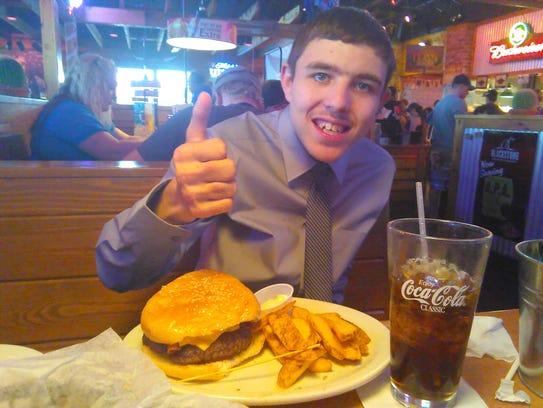 Jayce Wisenhunt enjoys dinner before going to his senior