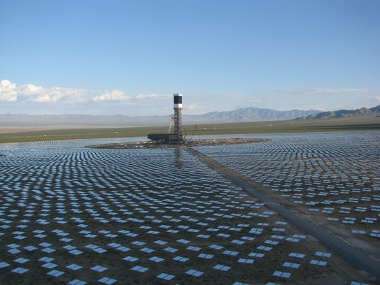 A 459-foot tall solar tower, surrounded by thousands