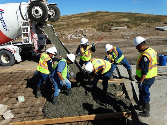 A Solid Waste Section crew headed by Miguel Fernandez,