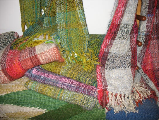 Local tapestry artist Mary Flad weaves scarves and