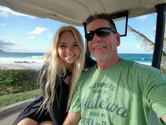 Tatum Mayers, who lives on Oahu, and her father, Larry Camp of Gilbert, in Hawaii.