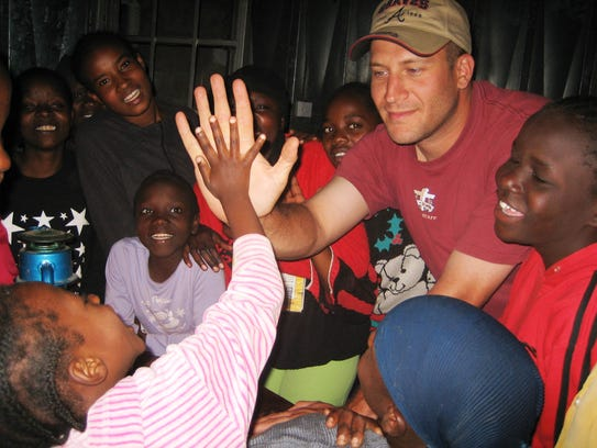 Dan Carr interacts with children in Kenya on one of