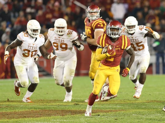 Oct 31, 2015; Ames, IA, USA; Iowa State Cyclones running back Mike Warren (2) out runs the Texas Longhorns defense during the fourth quarter at Jack Trice Stadium. The Cyclones beat the Longhorns 24-0.  Mandatory Credit: Reese Strickland-USA TODAY Sports