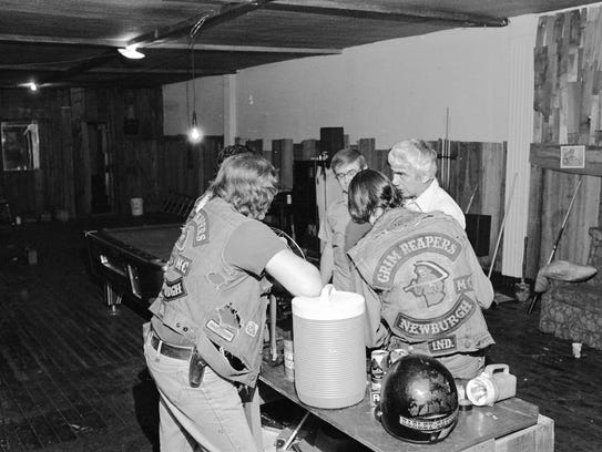 Grim Reapers Motorcycle Club members inside their clubhouse in Newburgh, Ind. in the late 1970's.