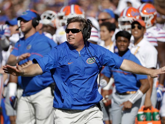 FILE- In this Jan. 2, 2017, file photo, Florida head coach Jim McElwain reacts to a dropped pass by Iowa during the first half of the Outback Bowl NCAA college football game in Tampa, Fla. Even though McElwain became the first coach to make the Southeastern Conference championship game in each of his first two seasons, his approval rating could use a boost. That's mostly because McElwain's offensive numbers have been, well, downright offensive during his time in Gainesville. (AP Photo/Chris O'Meara, File)