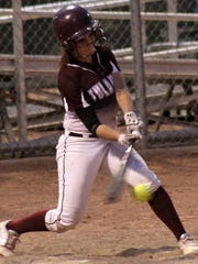 Tularosa junior Jade Yousif hits a ball Tuesday night at the Field of Dreams Softball Complex.
