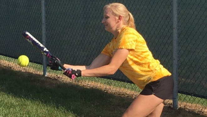 Tomahawk senior Rachel Dallman takes some bunting practice during practice Wednesday afternoon.