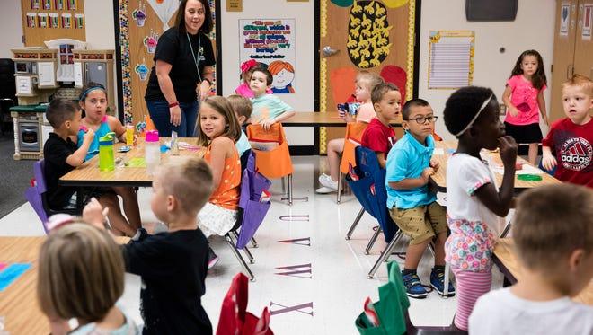 Kindergarten students adjust to their first ever day of school at Henryville Elementary School.