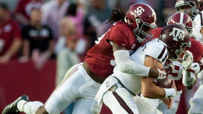Alabama linebacker Tim Williams (56) sacks Texas A&M quarterback Trevor Knight (8) late in the game at Bryant-Denny Stadium in Tuscaloosa on Saturday, October 22, 2016.