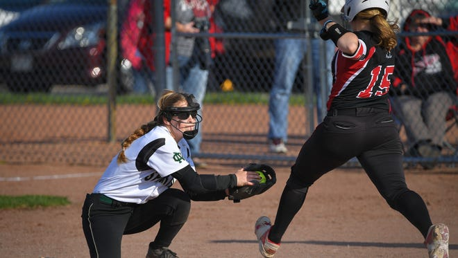 Lauren Neveau (4) of Oshkosh North beats Emily Cliver (15) to first base. The Oshkosh North Spartans battled the Hortonville Polar Bears to a 2-1 victory Friday evening at Oshkosh North High School.