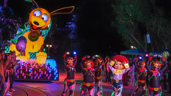 'PAINT THE NIGHT'  PARADE (ANAHEIM, Calif.)— Jessie from the Disney•Pixar 'Toy Story' films appears with parade performers in synchronized, LED costumes in this after-dark spectacular inspired by the iconic 'Main Street Electrical Parade.' 'Paint the Night' shimmers with vibrant color and more than 1.5 million, brilliant LED lights and features special effects, unforgettable music, and energetic performances that bring beloved Disney and Disney•Pixar stories to life. (Paul HIffmeyer/Disneyland Resort)