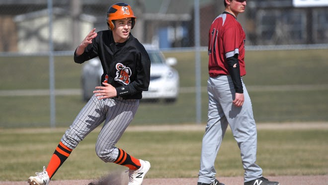 Jack Kinziger (2) of Ripon rounds second base. The Ripon Tigers hosted the Winneconne Wolves in an East Central Conference baseball game Tuesday afternoon, April 24, 2018 at Barlow Park.