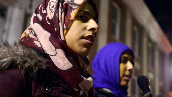 From left, South Burlington high school students Lena Ginawi and Kiran Waqar tell stories about prejudice and racists acts facing American muslims during a anti Trump protest at City Hall Park in Burlington on Friday, November 11, 2016.