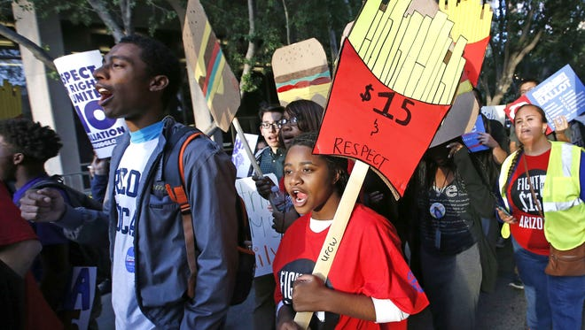 Several hundred people rallied in Phoenix in support of a hike in the minimum wage in November.
