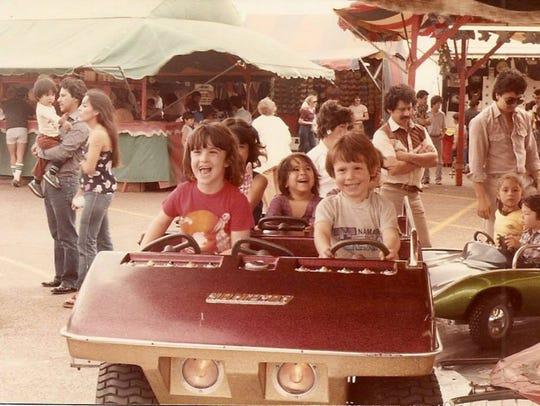 Chrissy Martin (far left) enjoys one of the rides at