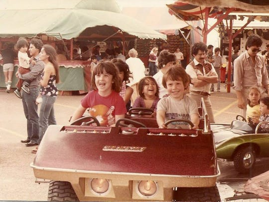 Chrissy Martin (far left) enjoys one of the rides at her family amusement park Magic Isles in Corpus Christi. Magic Isles was an amusement park located at SPID and Flour Bluff Drive from 1978 to 1984.