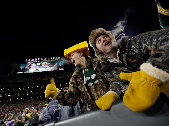 Green Bay Packers fans cheer at Lambeau Field.