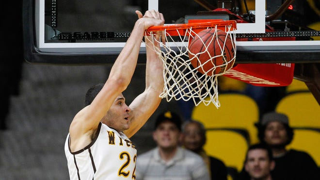 Feb 25, 2015; Laramie, WY, USA; Wyoming Cowboys forward Larry Nance Jr. (22) dunks against the Fresno State Bulldogs during the second half at Arena-Auditorium. The Bulldogs beat the Cowboys 64-59. Mandatory Credit: Troy Babbitt-USA TODAY Sports