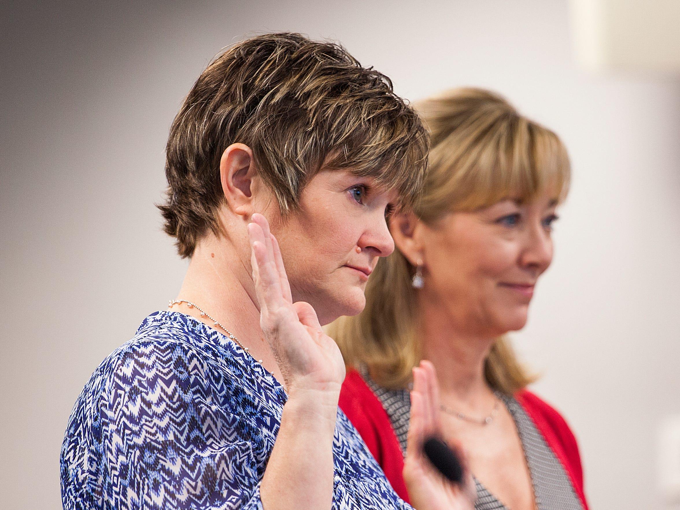 Julie Nowak, left, is sworn in before the Virginia