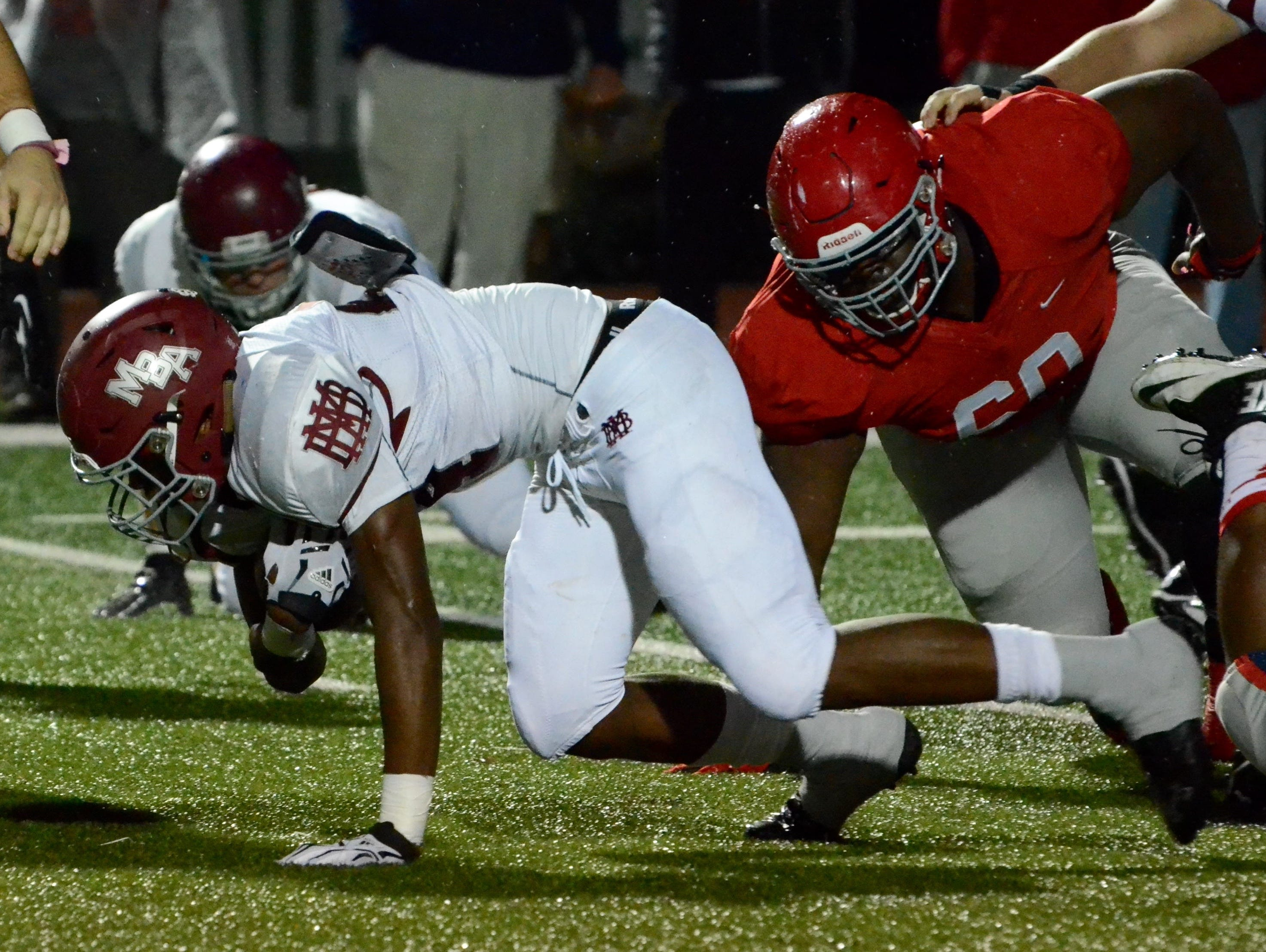 MBA running back Ty Chandler fights for extra yardage Friday against Brentwood Academy.