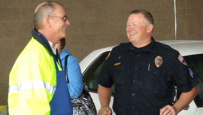 Retiring Windsor Police Chief John Michaels, left, and Lt. Rick Klimek chat in this 2011 file photo.